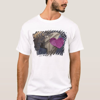 Lonely paper heart floating in a puddle. T-Shirt