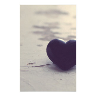 Lonely Purple Stone Heart on a Wet Sandy Beach Stationery