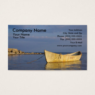 Lonely row boat at sunset business card