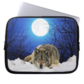 Lonely watcher wolf on a laptop sleeve