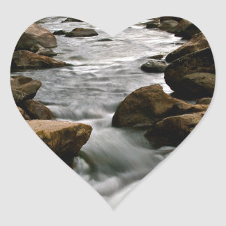 LONG EXPOSURE OF A RIVER AFTER A STORM HEART STICKER