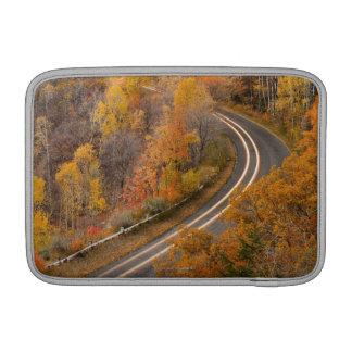 Long exposure of car driving on road through MacBook sleeve