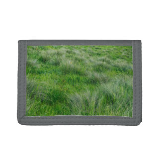 Long grasses in a vast grassland trifold wallets