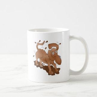 Long nosed dog shaking off the muck coffee mug