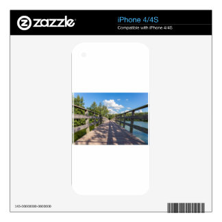 Long wooden bridge over water of pond iPhone 4 skins