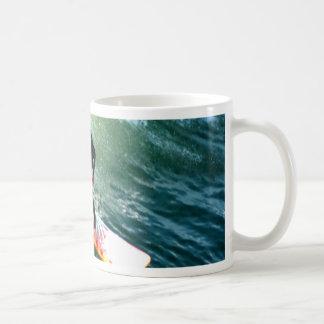 longboard surfer drops with wave coffee mug
