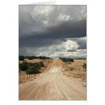 Looking down a  dirt country road in NM with Card