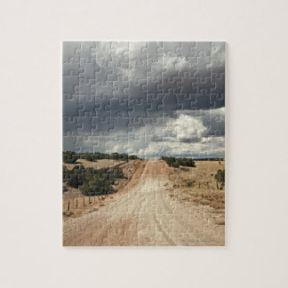Looking down a  dirt country road in NM with Jigsaw Puzzle