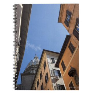 looking up at colourfully painted buildings and spiral notebook