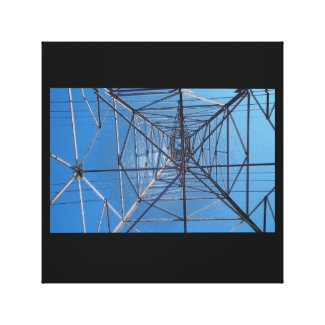 Looking up under the power lines tower
