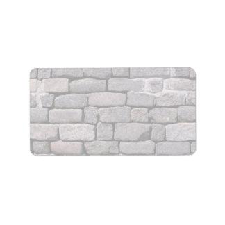 Loose brick wall address label
