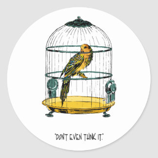 Loro en una jaula dorada pegatina redonda