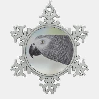 Loro magnífico del gris africano adorno de peltre en forma de copo de nieve