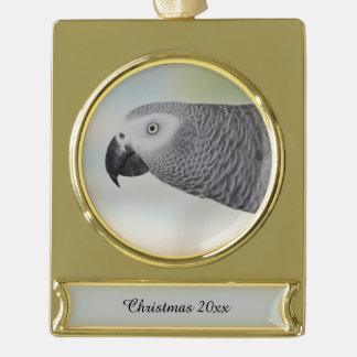Loro magnífico del gris africano adornos navideños dorados