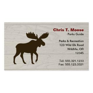 Los alces siluetean con el fondo de madera del tarjetas de visita