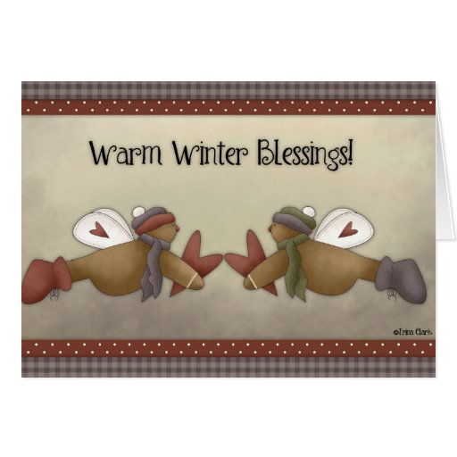 Los ángeles del pan de jengibre calientan la tarje tarjeta de felicitación