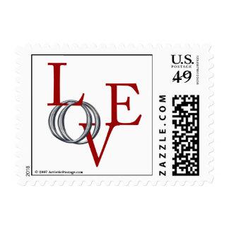 Los anillos de bodas del amor ahorran la sello