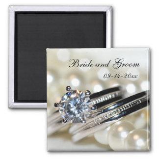 Los anillos y las perlas ahorran el imán del boda