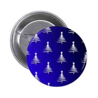 Los árboles de navidad se platean en azul de cobal pins