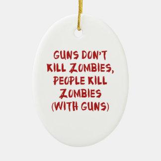 Los armas no matan a zombis adorno navideño ovalado de cerámica