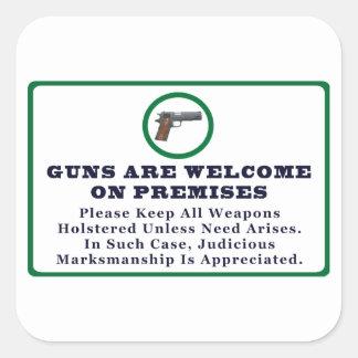 Los armas son agradables en muestra de las pegatina cuadrada