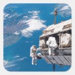 Los astronautas participan en el activi pegatina cuadrada