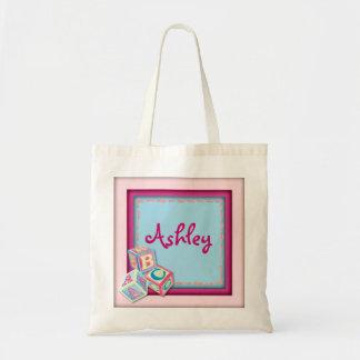 Los bloques rosados adaptables del bebé llevan el  bolsa tela barata