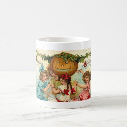 Los chicas de Halloween del vintage Morph la taza