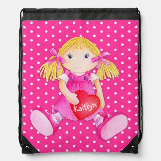 Los chicas nombran el bolso de lazo rosado del mochila