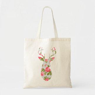 Los ciervos siluetean con los rosas florales román