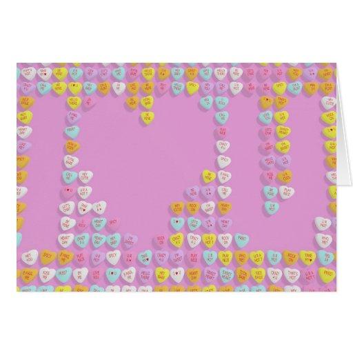 Los corazones del caramelo revelan la tarjeta del