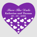 Los corazones púrpuras y blancos ahorran a los peg