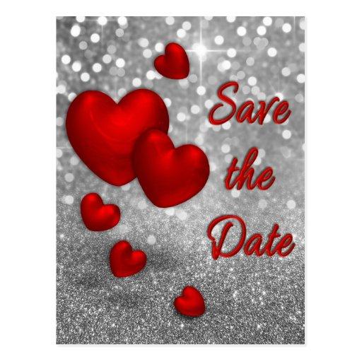 Los corazones rojos en el brillo de plata - ahorre postal