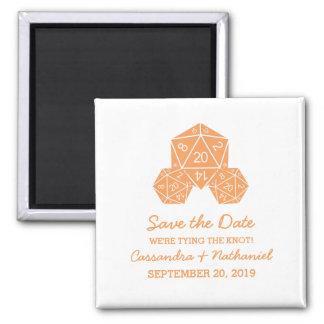 Los dados del naranja D20 ahorran el imán de la