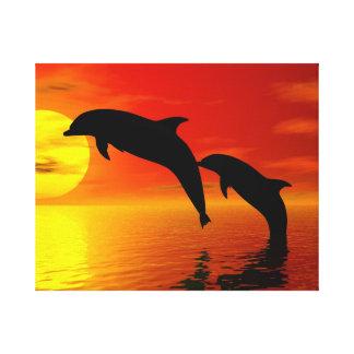 Los delfínes que saltan la galería de imágenes de impresion en lona