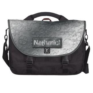 Los engranajes metálicos con la etiqueta empernada bolsas para portátil