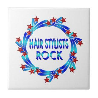 Los estilistas oscilan las estrellas rojas azulejo