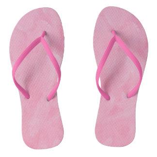 Los flips-flopes de las mujeres rosadas del hielo
