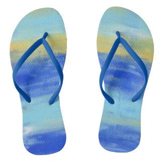 Los flips-flopes náuticos de las azules turquesas