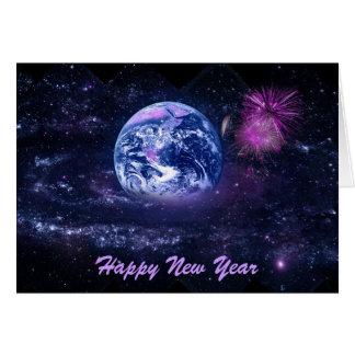 Los fuegos artificiales del Año Nuevo en espacio Tarjeta De Felicitación