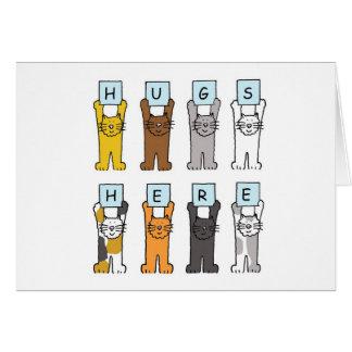 Los gatos abrazan aquí la tarjeta del estímulo