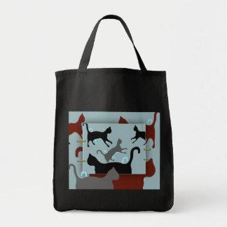 """Los """"gatos en el bolso"""" empaquetan - el bolso del  bolsas"""