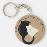 Los gatos, libros, vida son el llavero dulce v2