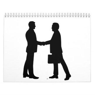 Los hombres de negocios sacuden las manos calendario de pared