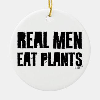 Los hombres reales comen las plantas ornamento para arbol de navidad