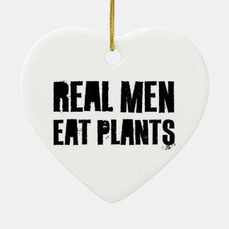 Los hombres reales comen las plantas ornamento para reyes magos