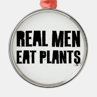 Los hombres reales comen las plantas adorno de navidad