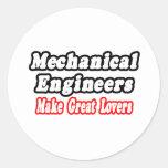Los ingenieros industriales hacen a grandes pegatina redonda