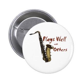 Los juegos manan saxofón pin redondo de 2 pulgadas