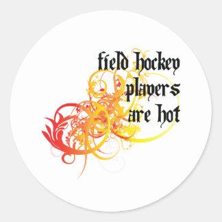 Los jugadores de hockey hierba son calientes pegatina redonda